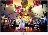 Photographer Paul Johnson documented this gorgeous Florida wedding. I love how the parasols are slightly akimbo. Source