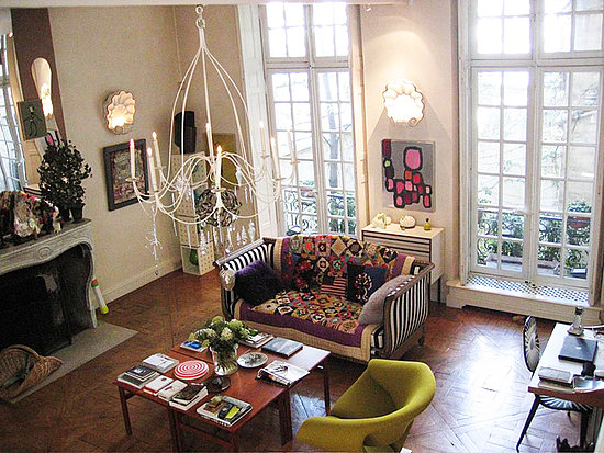 This living room in haute couturier Christian Lacroix's Paris apartment is to die for thanks to original Parisian details such as gilded moldings and French doors opening onto petite balconies, but his theatrical personal style, fabulous furnishings, and unique art collection win me over equally as well. Source