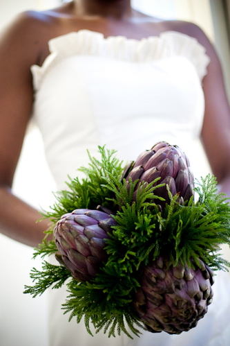 This beautiful bouquet uses purple artichokes and ferns. Source