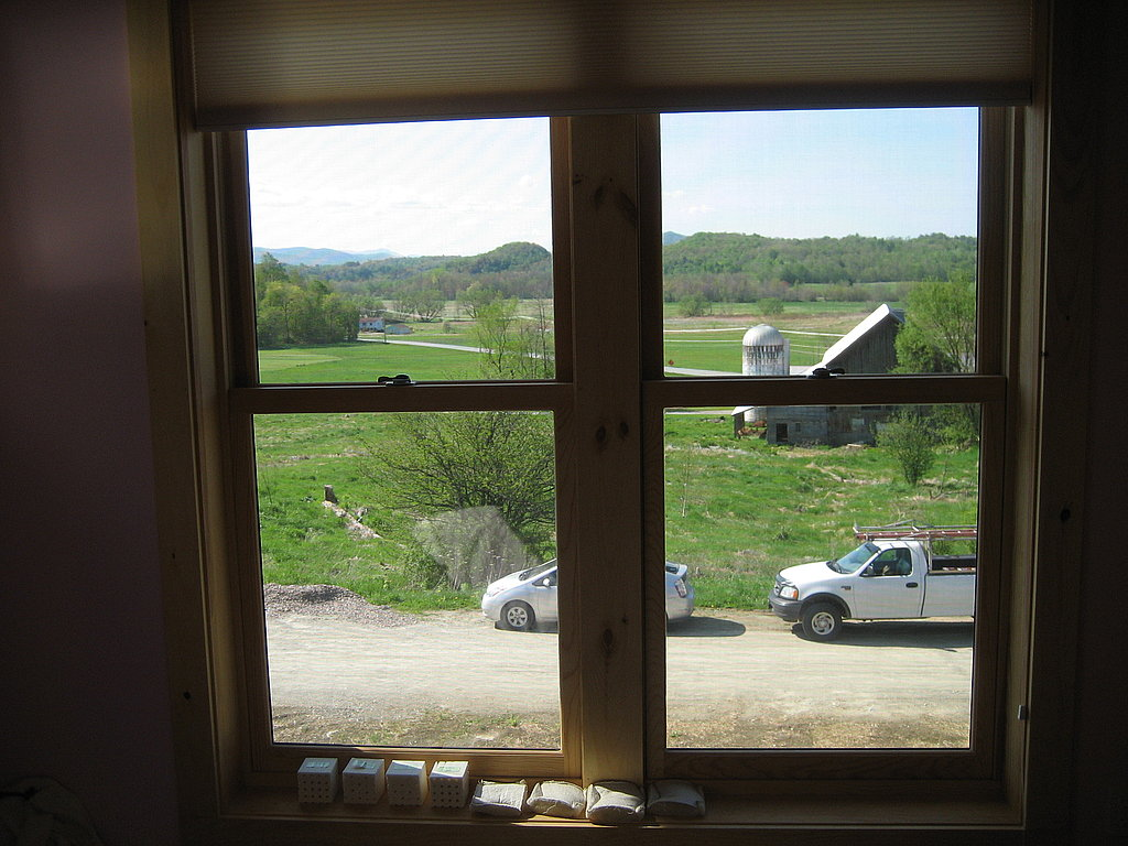 The super-efficient, triple-glazed windows prevent heat loss, while also providing lovely views of the surrounding farmland.